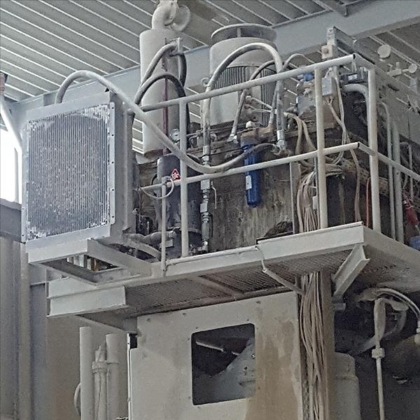 Kalksandsteinpresse mit CJC Nebenstromfilter